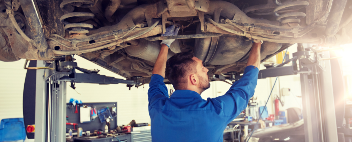 Mechanic pouring in engine oil - Car Servicing Westcliff